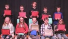 Finalists who competed in the Geography Bee Jan. 21, first row from left: Avery Jurgens, Kendall Siebels, champion River Smith, runner-up Nick Welter and Matthew Luke. Second row: Royce Kiburz, Brady Gogel, Kyle Cox, Jonah Luensman and Ty King.