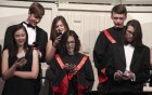 "Members of the Forte singers use their phones as props while singing ""I Want to Stare at My Phone With You. They include, first row from left: Kaitlin Guyer, Marianne Fanning and Dalton Hampson. Second row: Jeff Carlson, Mya Boffeli and Sully Flynn."