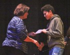 Caelum Jones (right) is among seventh-graders receiving certificates from Kathy Larson.