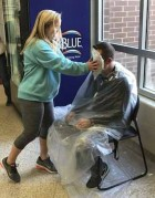 """Monticello High School teacher Wes Wilson gets a pie in the face from freshman Sydney Freeze March 29. As part of the school's Positive Behavioral Interventions and Supports (PBIS) reward system, teachers give out """"Panther Positive"""" tickets for displaying positive behavior. Tickets are then entered in a weekly drawing, and winning students get to spin the """"wheel of prizes"""" to see what they receive; a pie in a teacher's face is one of the options. (Photo submitted)"""