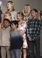 Fourth- and fifth-graders sing during the Sacred Heart concert. They include, first row from left: Alan Arriaga and Gabe Carranza. Second row: Lindsi Olson, Layni Tallman and Emmit Rickels. Third row: Gabby Donovan and Halle Recker.