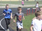 Hustling around the track during the PTO Walk-A-Thon are Mason McAtee (left) and Reid Hinrichs.