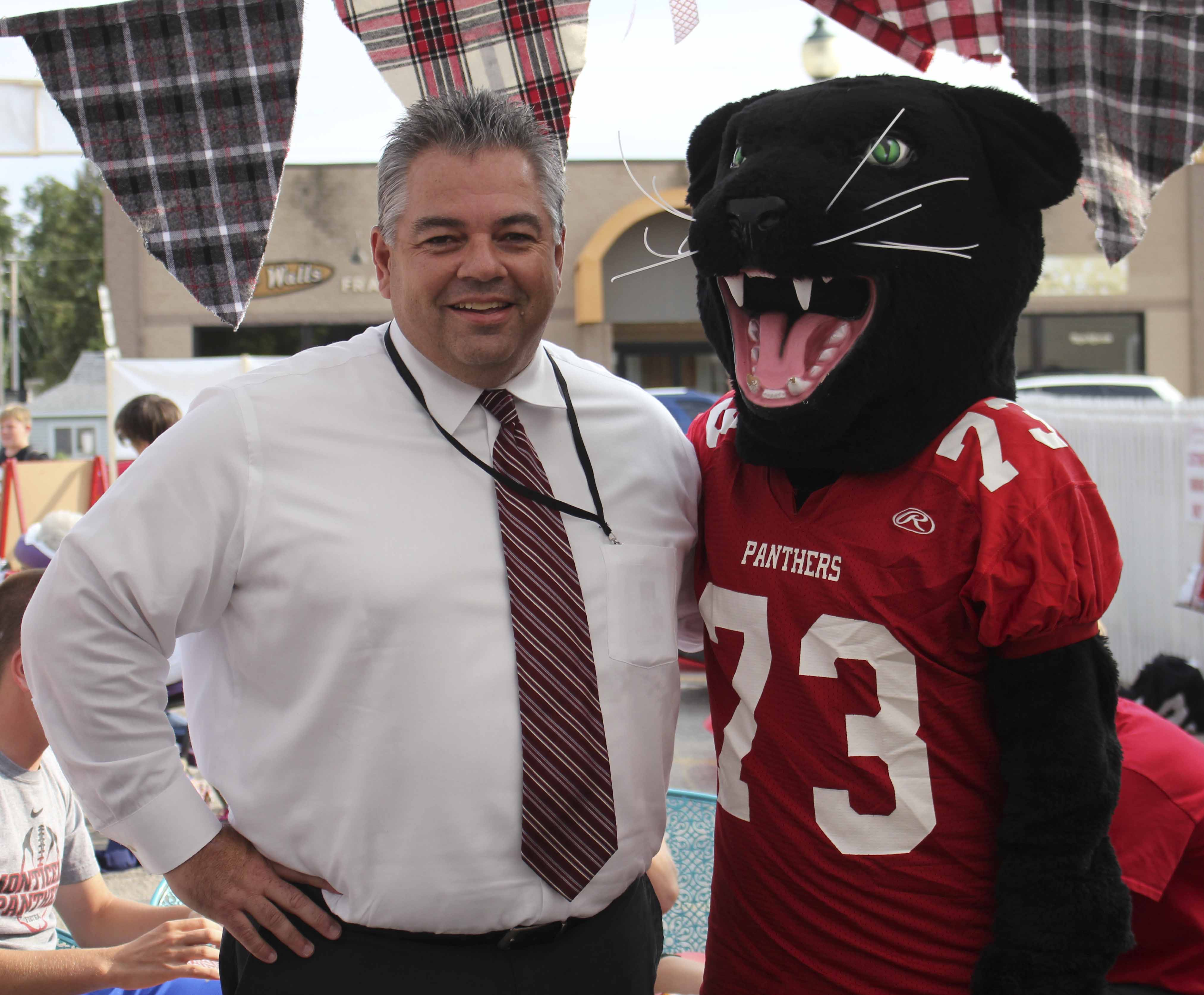 Superintendent Brian Jaeger poses with the Panther mascot during the Tailgate Party.
