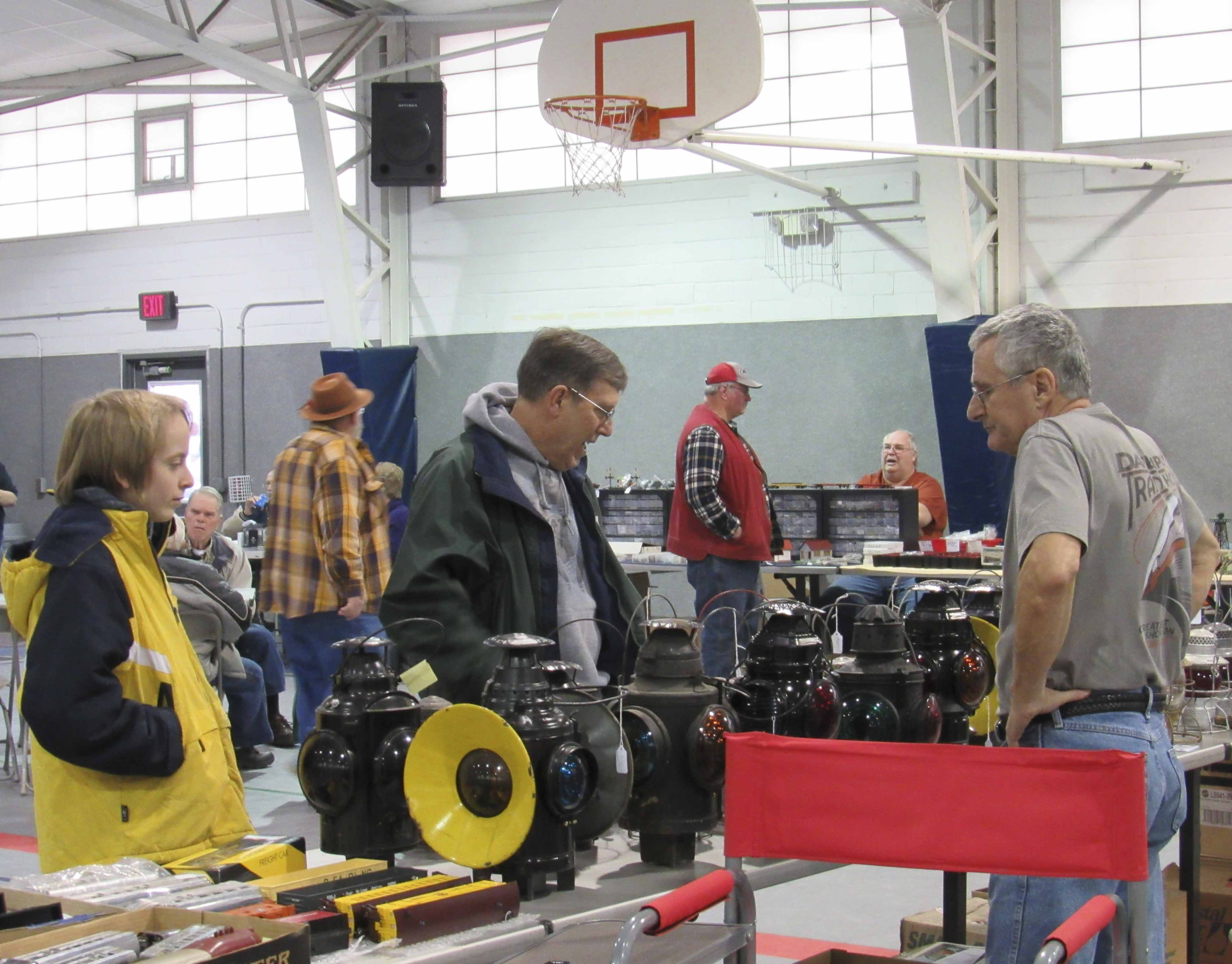 The First Annual Train show & Swap Meet was held on Jan. 29 in Monticello. This was a fundraiser for the Maquoketa Valley Model Railroad Club, which includes Monticello, Manchester, Cascade, Central City and more. Bill Lindsay of Ainsworth, Iowa visits with customers Doug Busch and Zame Hackl. Lindsay is a dealer of railroad items, such as these lanterns. (Photos by Kim Brooks)